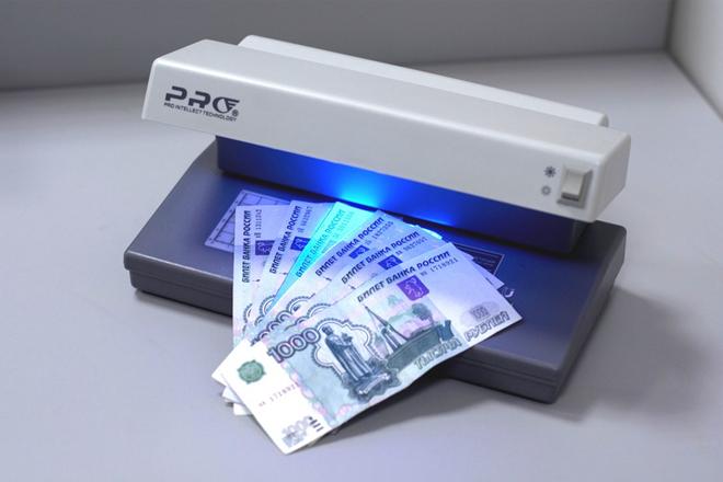 Аппарат для проверки подлинности денег